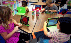 a classroom of students use iPads